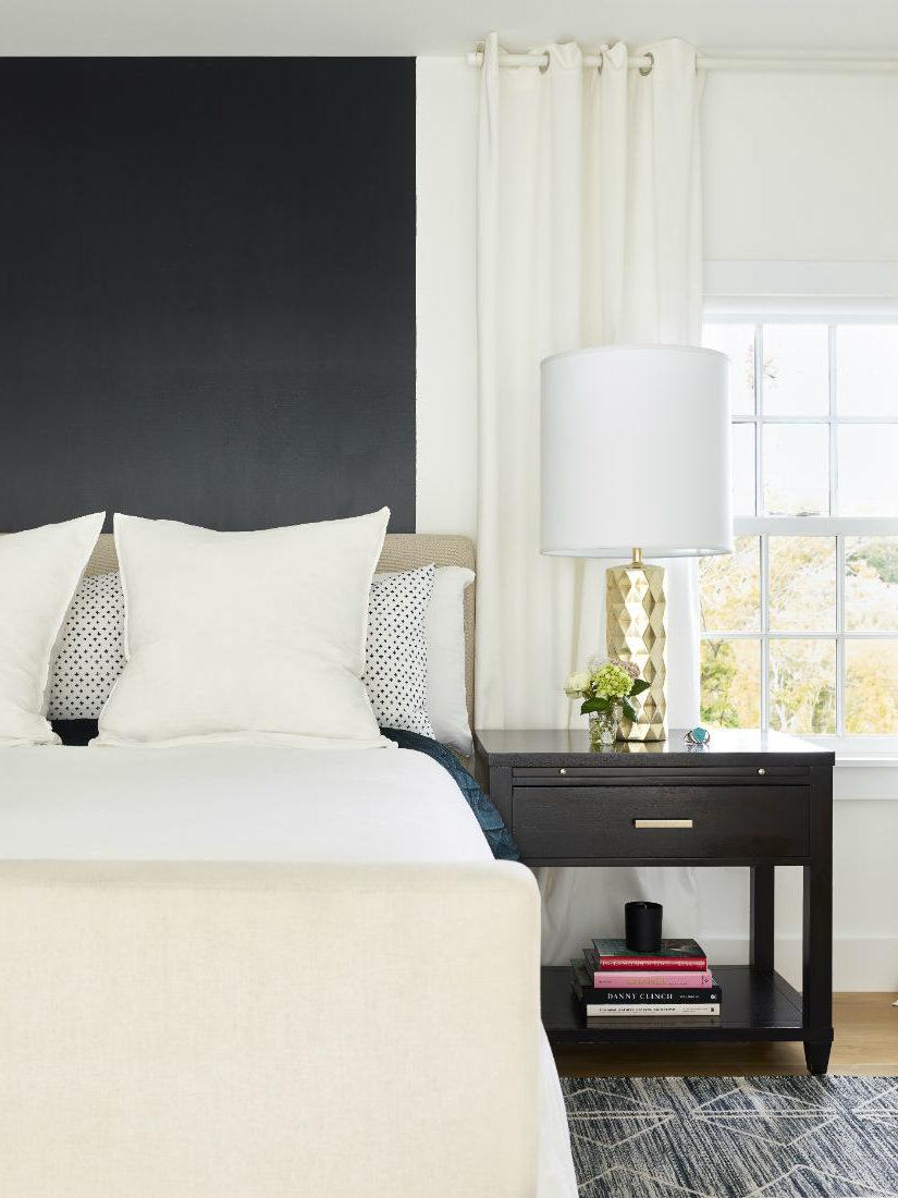 white-duvet-white-pillows-black-nightstand-master-bedroom